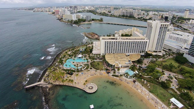 The Caribe Hilton Hotel in San Juan, Puerto Rico, as seen from the air last month. The territory's government has managed to buy some time to stave off an economic crisis as the island tries to pay off billions in public debt.