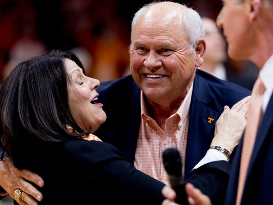 Athletics Director Phillip Fulmer hugs University of Tennessee Chancellor Beverly Davenport during a game between Tennessee and Georgia at Thompson-Boling Arena in Knoxville on March 2, 2018.