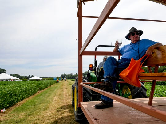 Buddy Petty sips on a glass of water while being driven around the demonstration and lecture tents at the 30th Milan no-Till Crop Production Field Day at AgResearch and Education Center in Milan, Tenn., Thursday, July 26, 2018.