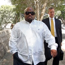 Cee Lo Green leaves Los Angeles Superior Court after a hearing Friday, Aug. 29, 2014.