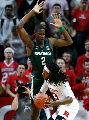 Michigan State Spartans forward Jaren Jackson Jr. (2) defends against Rutgers Scarlet Knights forward Deshawn Freeman (33) during first half at Louis Brown Athletic Center.