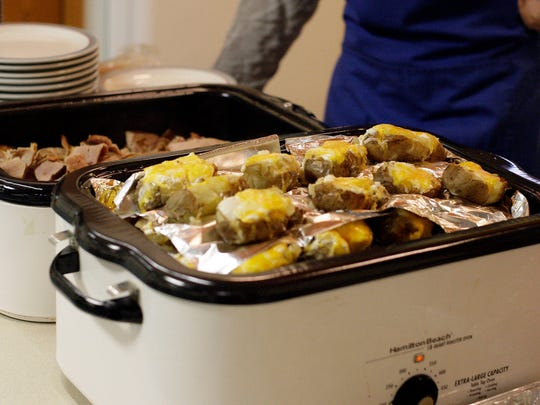Food awaits people who attend the Welcome Table meal Tuesday October 28, 2014 at Redeemer Lutheran Church in Plymouth.