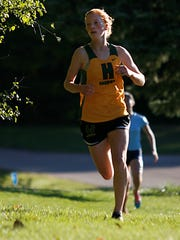Third-place Anya Turner was the top runner for the second-place Hawks.
