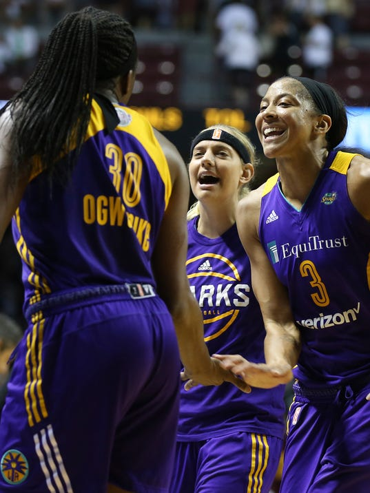 Los Angeles Sparks center Candace Parker (3) celebrates with teammate forward Nneka Ogwumike (30) after their team won 85-84 in Game 1 in the WNBA basketball finals against the Minnesota Lynx, Sunday, Sept. 24, 2017, in Minneapolis. (AP Photo/Stacy Bengs)