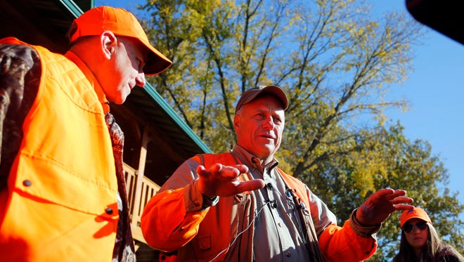 Rep. Steve King of Iowa takes questions from reporters after hunting pheasants in Akron, Ia., on Oct. 28.