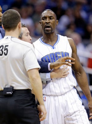 Orlando Magic guard Ben Gordon, right, talks with referee Kane Fitzgerald before he was ejected Jan. 31, 2015, in Orlando.