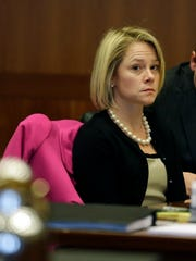 Gov. Chris Christie's former deputy chief of staff, Bridget Anne Kelly, waits in court for a hearing Tuesday, March 11, 2014, in Trenton, N.J. (AP Photo/Mel Evans, Pool)