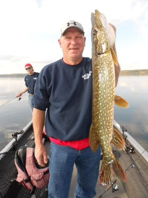 Larry Ness of Cedar Rapids, IA, with a Northern pike caught in the Hayward area in September 2014.