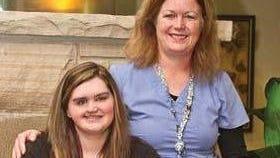 Kelley Sperry and Nurse Katie Klinger, with Kobi.
