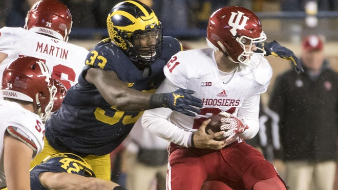 Three mock drafters predict the Lions will select Michigan defensive end Taco Charlton in the first round Thursday.