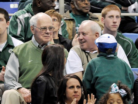 Former Spartan head coach Jud Heathcote, left, has