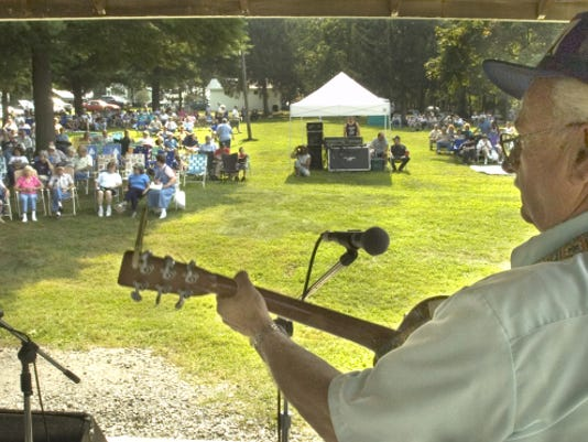 Osborne Burkins, right, plays to a good crowd late Saturday morning at the York County Fiddlers Convention in 2004.