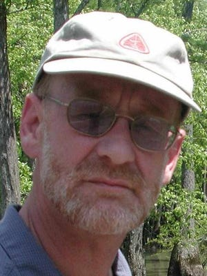 Gene Sparling said he saw an Ivory billed woodpecker in the swamp Bayou DeView, in Arkansas, a few miles from where he found the bird in February 2004. (