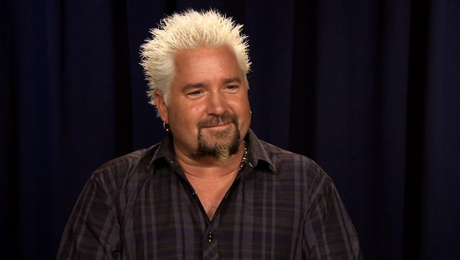 This Oct. 11, 2016 image taken from video shows celebrity chef Guy Fieri during an interview in New York.