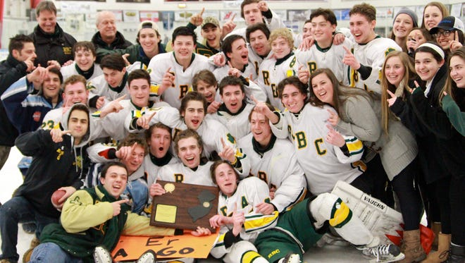 Red Bank Catholic celebrates its 2014-15 Shore Conference Tournament title.