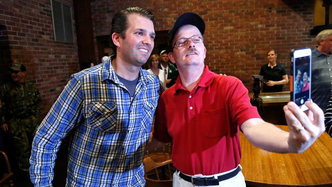 Donald Trump Jr. poses for a photo with Lee Hinesley after a brief campaign stop for his father, Republican presidential frontrunner Donald Trump, Thursday, April 28, 2016, at the Beef House restaurant in Covington. Trump Jr. was in the area turkey hunting with friends. Hinesely is from Clinton, Indiana.