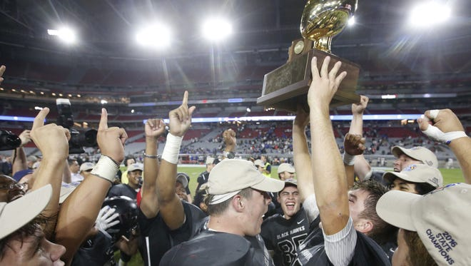 Williams Field's football team celebrates after winning the 5A conference state championship game against Centennial at University of Phoenix Stadium in Glendale on 11/26/16.