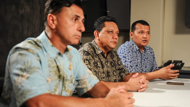 In this file photo, Roy Quintanilla, right, is seated with Walter Denton, left, and Roland Sondia. The three men said they were sexually abused by Archbishop Anthony Apuron when they served as altar boys at the Agat church in the 1970s.