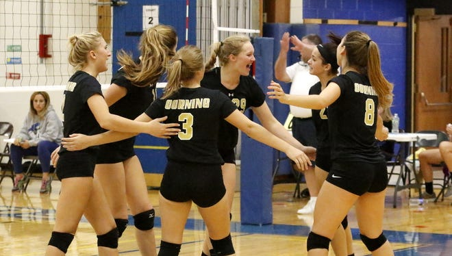 Corning players celebrate a point Oct. 21 during the Horseheads Volleyball Classic.