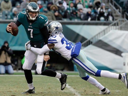 Philadelphia Eagles' Nate Sudfeld, left, is tackled by Dallas Cowboys' Anthony Brown during the second half of an NFL football game, Sunday, Dec. 31, 2017, in Philadelphia.