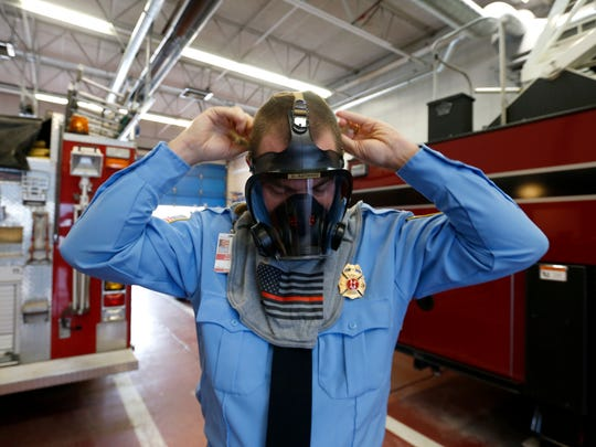 Bolivar City Fire Department Capt. Robert Anthony shows how a compressed-air mask is worn on Monday, Jan. 8, 2018. Masks becoming covered in ice was a major challenge the firefighters faced when battling a fire in negative temperatures.