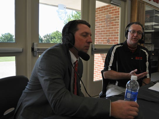 New baseball coach Travis Janssen talks with radio