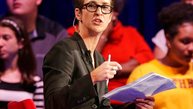 In this Friday, Nov. 6, 2015, file photo, MSNBC's Rachel Maddow speaks during a Democratic presidential candidate forum at Winthrop University in Rock Hill, S.C. Maddow has turned politics into prime-time entertainment for people worried about the state of the new presidency. MSNBC achieved other milestones in July, including its closest finish to Fox since 2000 and largest margin of victory over CNN ever.