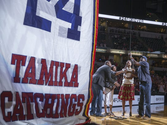 Retired Indiana Fever great Tamika Catchings, who holds