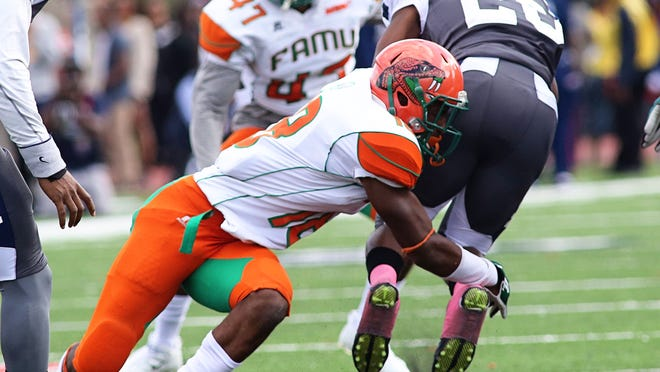 FAMU linebacker Jacques Bryant put a stop on Howard running back Aquanis Freeman during their Saturday afternoon game at Green Stadium.