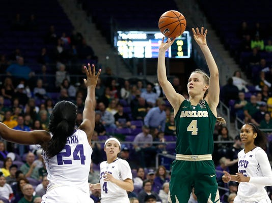 Baylor guard Kristy Wallace (4) shoots over TCU forward Dakota Vann (24) during the first half of an NCAA college basketball game, Saturday, Feb. 24, 2018, in Fort Worth, Texas. (AP Photo/Ron Jenkins)