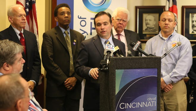 Mayor John Cranley announced his 2015 budget proposal Wednesday at Cincinnati Police District 1 headquarters. Flanking him are Councilman Christopher Smitherman (left) and Vice Mayor David Mann (right)