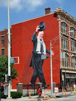 Mr. Tarbell Tips HIs Hat is an ArtWorks mural in OTR on the side of 1109 Vine St. near the heart of the neighborhood's restaurant and bar scene.