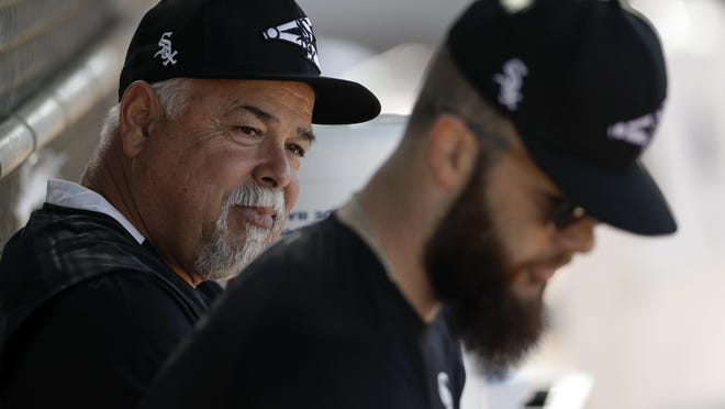 Chicago White Sox manager Rick Renteria, left, talks with pitcher Dallas Keuchel, right, during a spring training practice last Saturday in Phoenix.