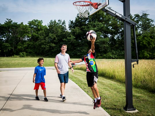 """Ball State coach James Whitford plays a morning game of """"21"""" with his two sons at their Muncie home."""