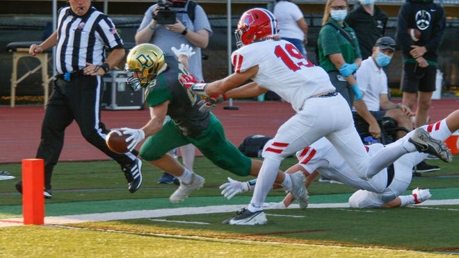 Dublin Jerome's Preston Everhart gets the tip of the ball over the goal line for a touchdown against Thomas Worthington on Sept. 4. The Celtics won 56-21.
