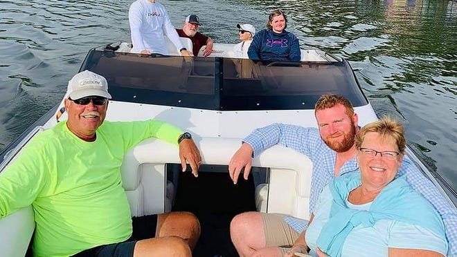 Kelley (back right) with her family and friends taking a boat ride on Lake of the Ozarks. After making a Facebook post, strangers came to their aid including a couple from California who took them on a ride in a go-fast boat to surprise Kelley for her 29th birthday.