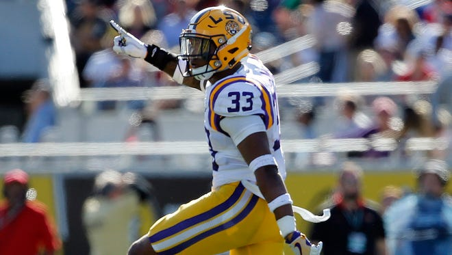 LSU Tigers safety Jamal Adams (33) reacts after they they stopped Louisville Cardinals on fourth down during the second half at Camping World Stadium.