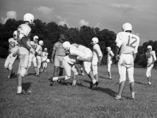 Leon football coach Gene Cox watches over a practice on Sept. 23, 1963, his first season as coach. Cox commuted from Live Oak every afternoon while still under contract with Suwannee High School.