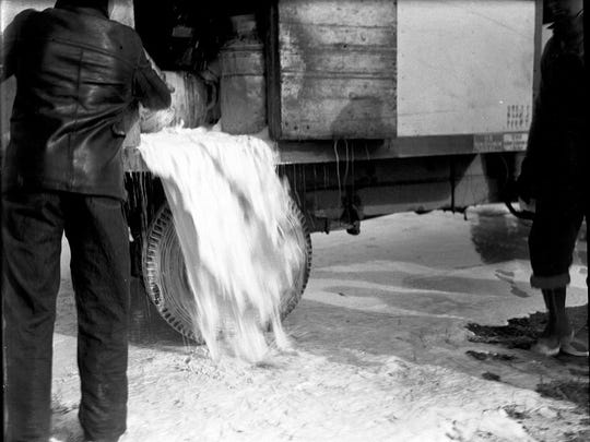 Milk is dumped into ditches from truck hauling can