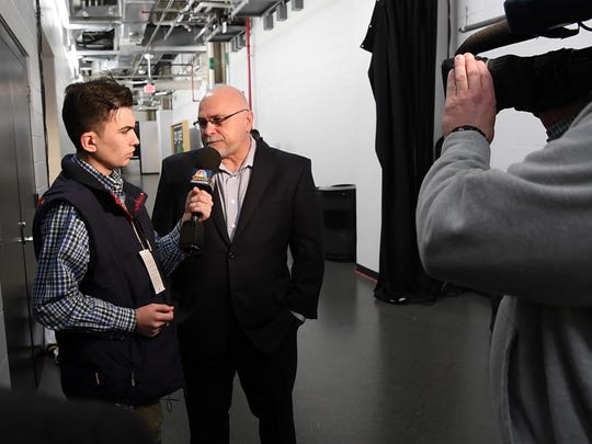 Jefferson High School senior Peter Fifoot, left, interviews Washington Capitals head coach Barry Trotz before his team faces the New Jersey Devils in Newark, New Jersey on Thursday, Jan. 18, 2018. Fifoot, who is on the Autism spectrum, wants to become a sports broadcaster.