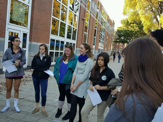 University of Delaware students gather outside the Trabant University Center for a commemoration honoring fallen college student Matthew Rosin on Sunday, Oct. 23, 2016.