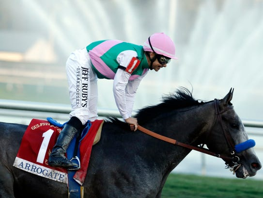 Arrogate, with jockey Mike Smith up, passes the finish