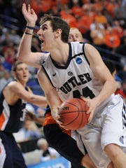 Butler's Andrew Smith drives around Bucknell defenders and toward the basket during a NCAA tournament game at Rupp Arena in Lexington, Kentucky on March 21, 2013. Butler won 68-56.