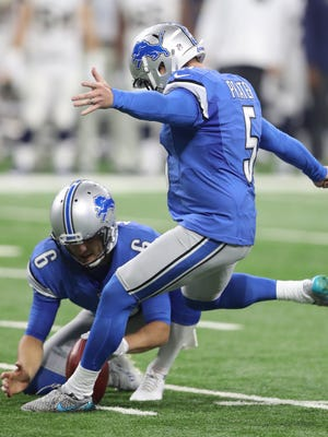 Lions kicker Matt Prater kicks the winning 34-yard field goal out of the hold from punter Sam Martin late in the fourth quarter against the Los Angeles Rams on Sunday, Oct. 16, 2016 at Ford Field in Detroit.