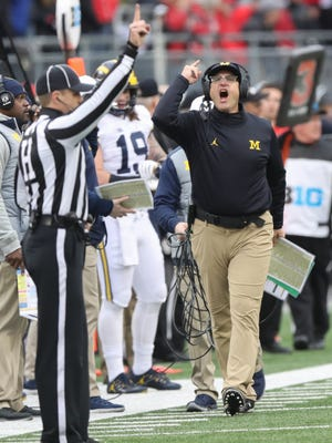 Michigan head coach Jim Harbaugh protests a call during the second half against Ohio State on Saturday, Nov. 26, 2016 at Ohio Stadium.