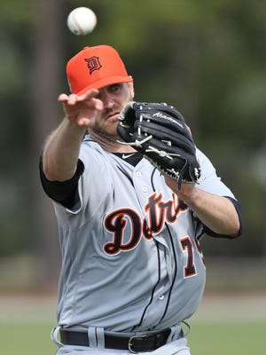 Detroit Tigers pitcher A.J. Achter goes through drills during Tigers Spring Training Wednesday February 15, 2017 at Publix Field at Joker Marchant Stadium in Lakeland Florida. Kirthmon F. Dozier/Detroit Free Press