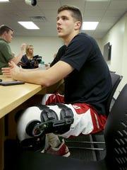 Indiana University's Collin Hartman, with heavy knee