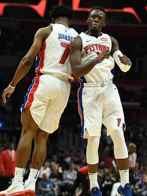 Stanley Johnson, left, celebrates with Reggie Jackson after sinking a three-point basket in the fourth quarter of the Pistons' 95-87 win over the Clippers, Saturday, Oct. 28, 2017 in Los Angeles.