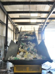 Plastic containers climb up a conveyor belt system