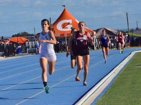 Fort Myers High School's Krissy Gear, left, captured the girls 3A 1,600-meter run Saturday at the state track meet in Bradenton, completing the first sweep of distance races since 2012 and only the second since 1982.